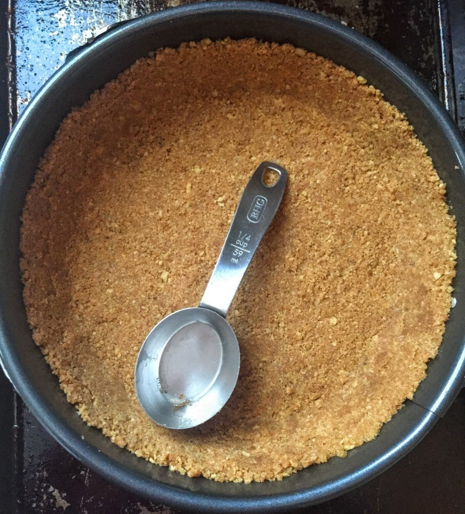 This is a trick I stole from Sally's Baking Addiction: Use a measuring cup to press the crust mixture into the bottom and up the sides of the pan.