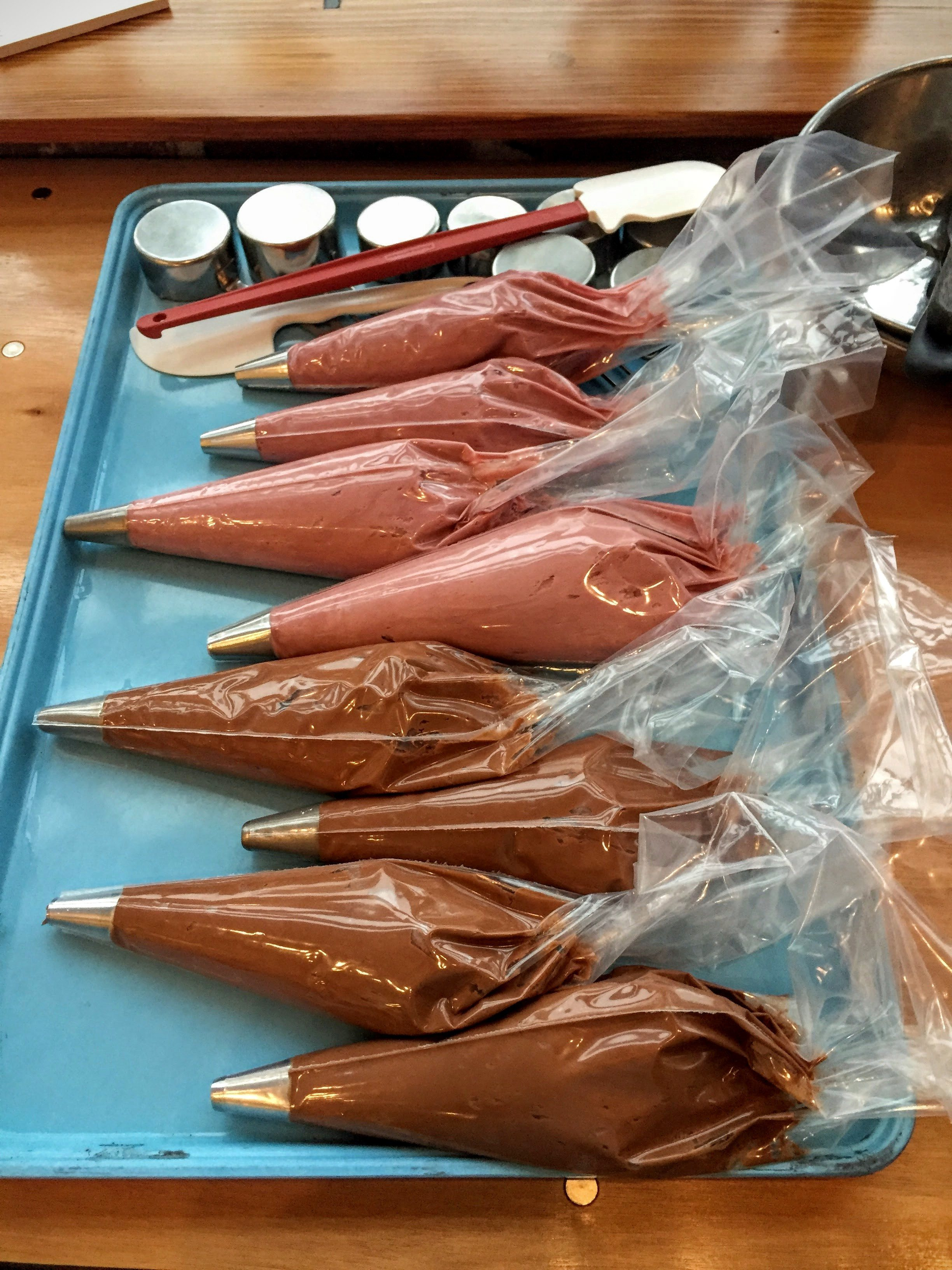 One of the first things I saw when we walked into the building were these piping bags full of frosting. They were for our decorating portion of the tour, and they contained chocolate icing and red wine icing (yes, I said red wine!!!)!