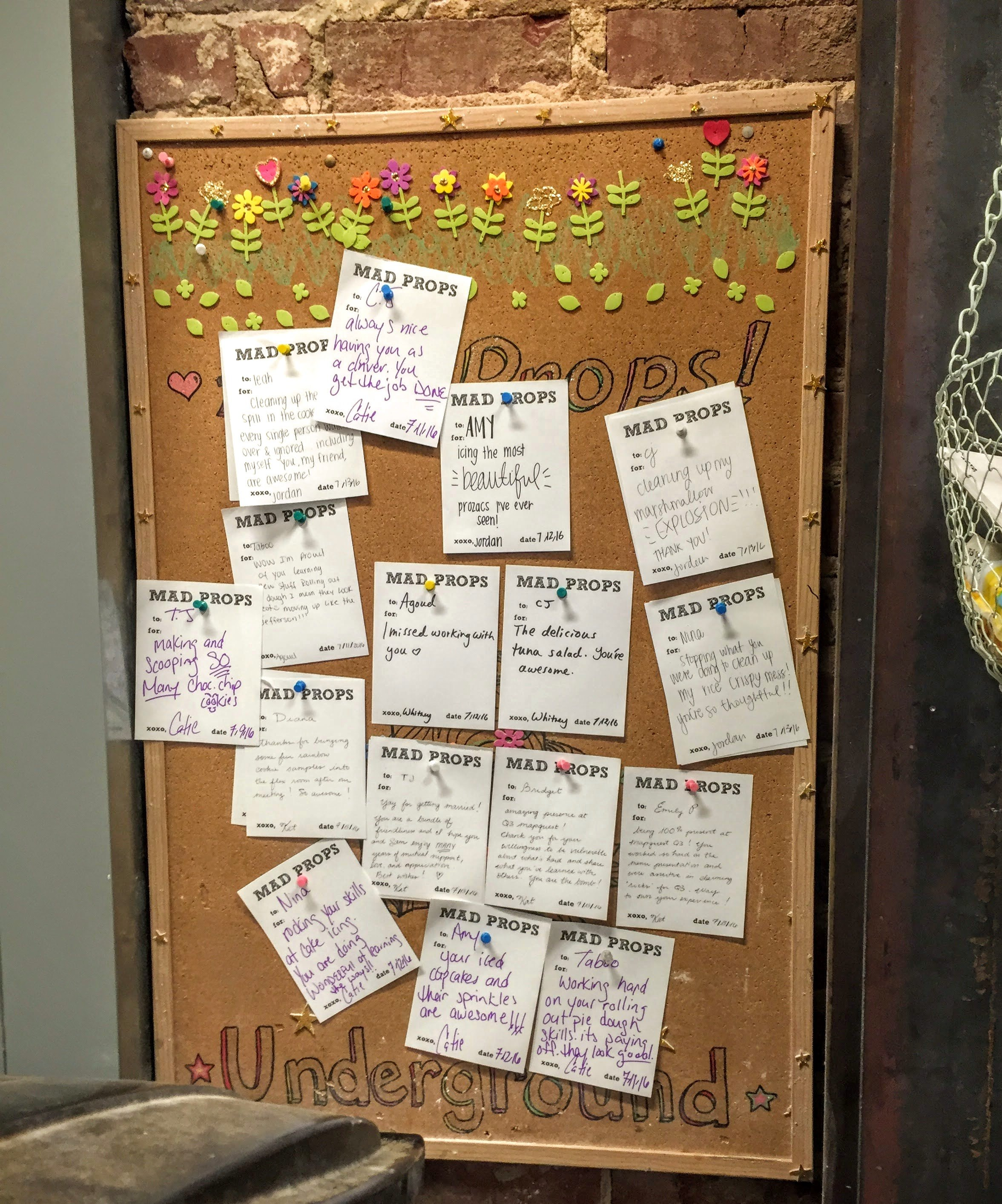 "As we continued and ventured into the cleaning closet and storeroom, we stopped by this ""Mad Props"" board, which is where Muddy's employees write shout outs about/for each other."