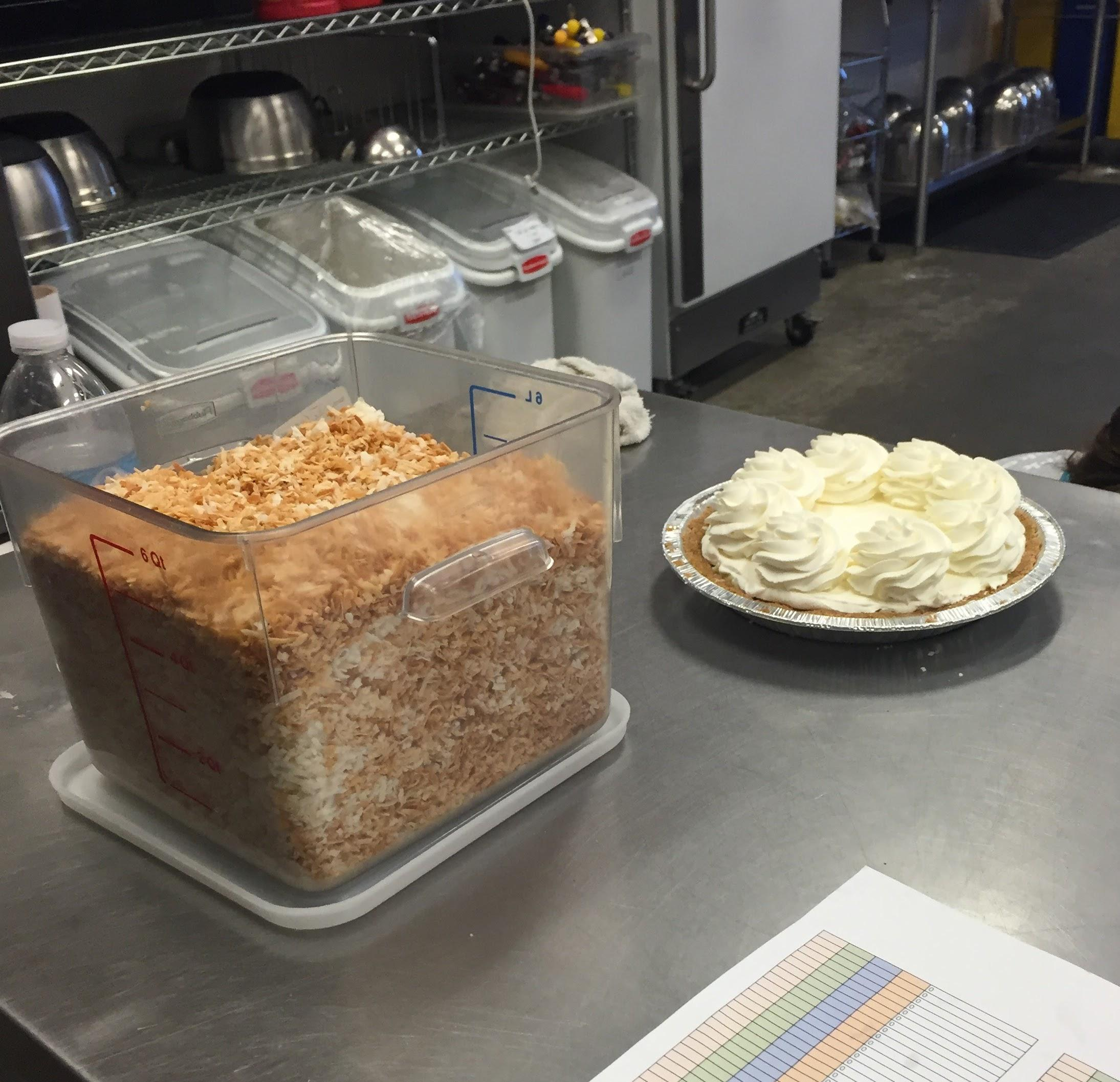 Once back in the kitchen area, we got to see a baker top off this coconut cream pie! Check out all of that toasted coconut!